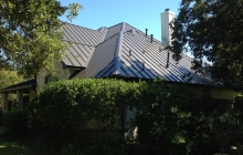 Standing seam metal roof installer